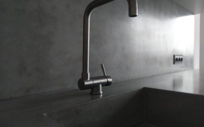 The kitchen interior arrangement with a concrete countertop